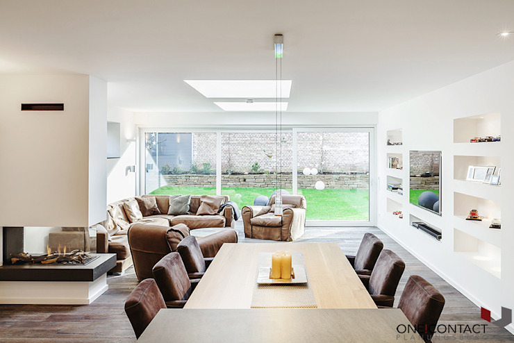 Modern living room by ONE!CONTACT - Planungsbüro GmbH Modern