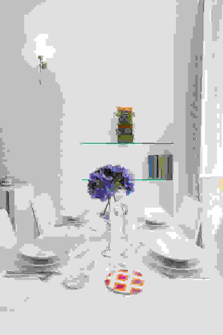 Tania Mariani Architecture & Interiors Ruang Makan Gaya Eklektik Kaca White