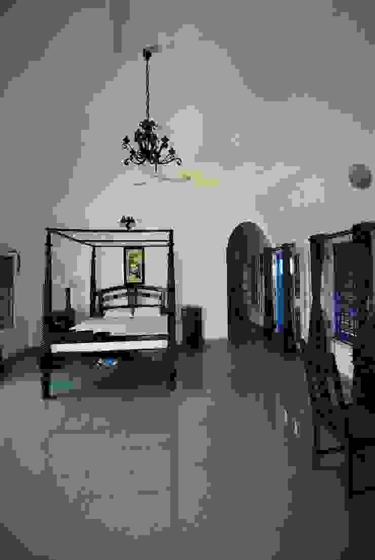 Vaulted Bedroom Mediterranean style bedroom by The White Room Mediterranean