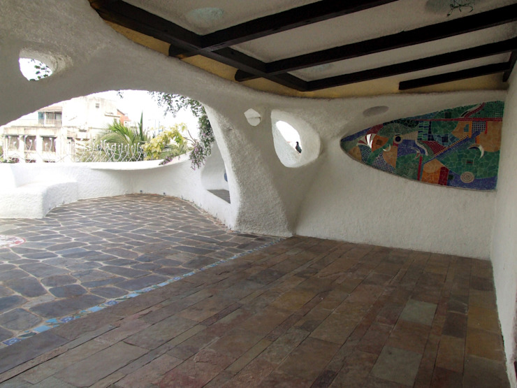 Wooden ceiling with stucco plaster Mediterranean style garden by The White Room Mediterranean Concrete
