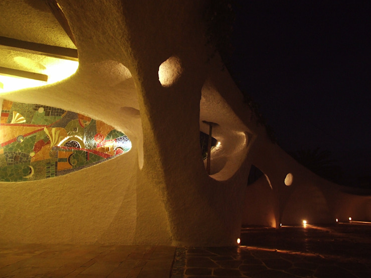 Arched openings at night Mediterranean style garden by The White Room Mediterranean Concrete