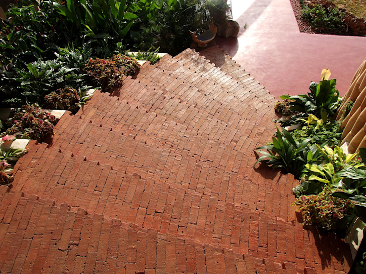 Close up of Brick steps Mediterranean style garden by The White Room Mediterranean