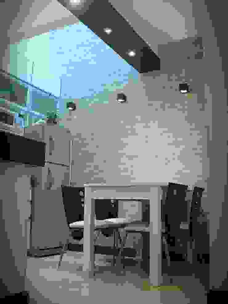Cocinar bajo la luz cenital Cocinas minimalistas de Estudio M Minimalista