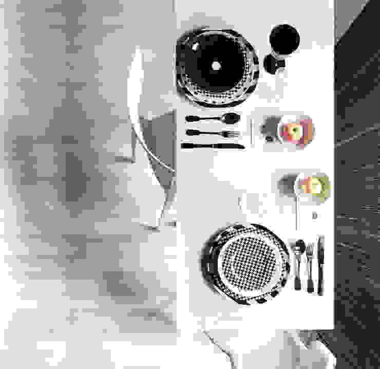 Salle à manger minimaliste par LDA.iMdA architetti associati Minimaliste