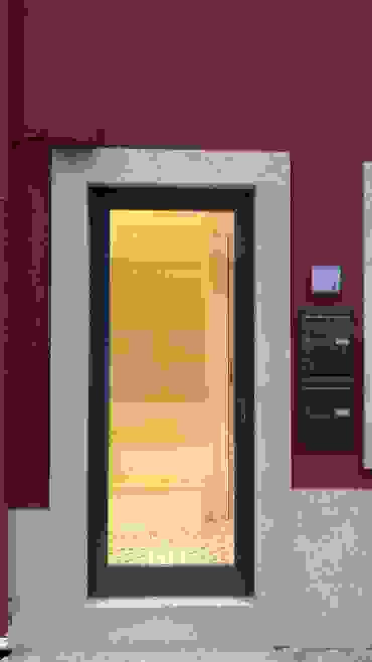 Entrada do prédio - Depois por Alma Prima Construções,Lda.