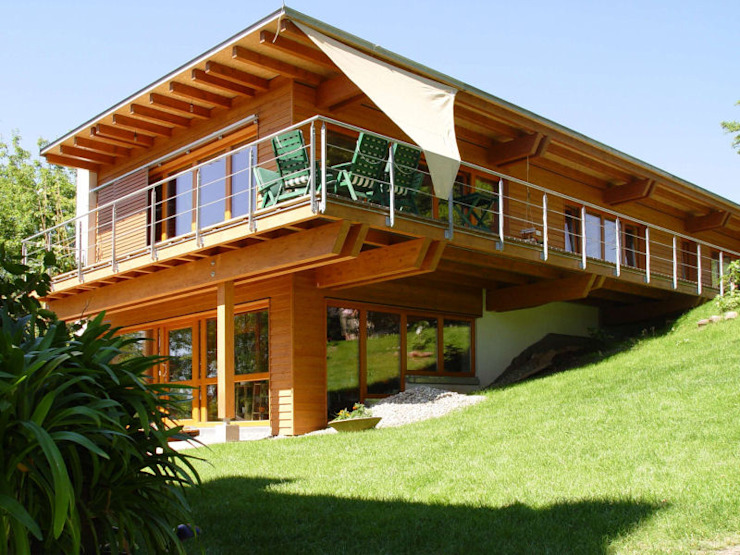 Дома в стиле модерн от Architekturbüro Andreas Madreiter Модерн Дерево Эффект древесины