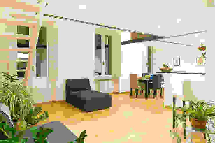 Phòng khách phong cách tối giản bởi homify Tối giản