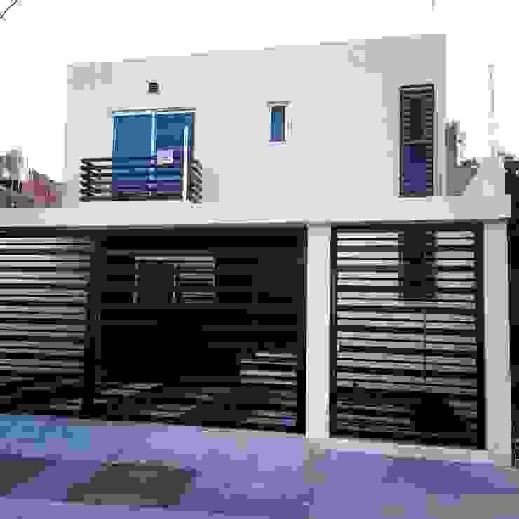 Fachada Frontal Balcones y terrazas minimalistas de Grupo Arquitech Minimalista Piedra