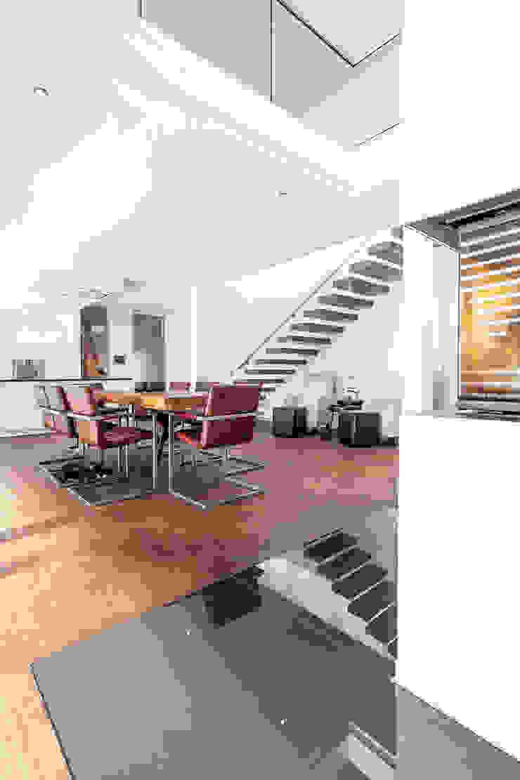 Modern dining room by Herzog-Architektur Modern