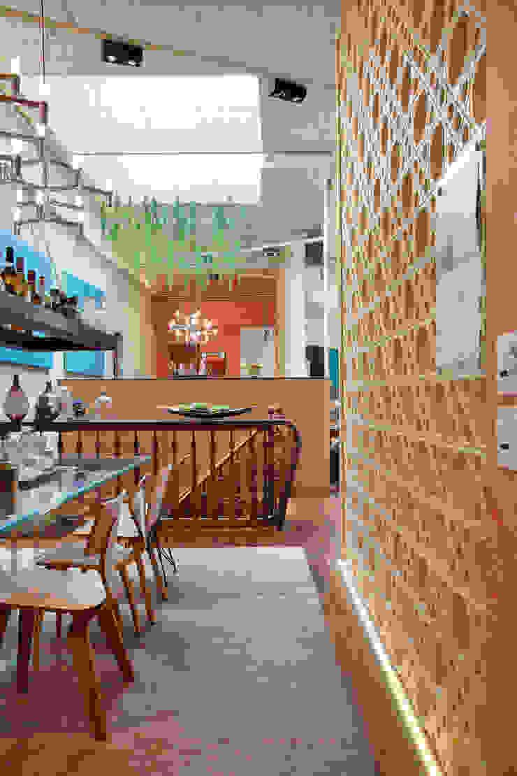 Sala da pranzo eclettica di Estúdio Barino | Interiores Eclettico