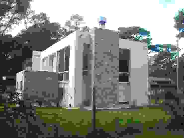 Estudio Arquitectura Integral Rumah Modern Beige