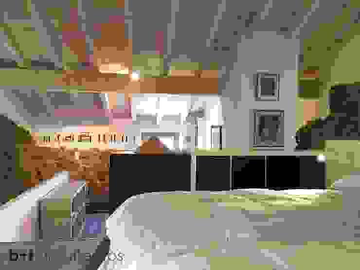 Zona de descanso Dormitorios rurales de b+t arquitectos Rural
