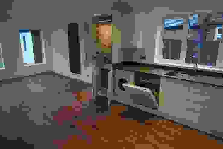 Beautiful Family Home Cocinas modernas: Ideas, imágenes y decoración de Thompson McCabe Moderno Madera Acabado en madera