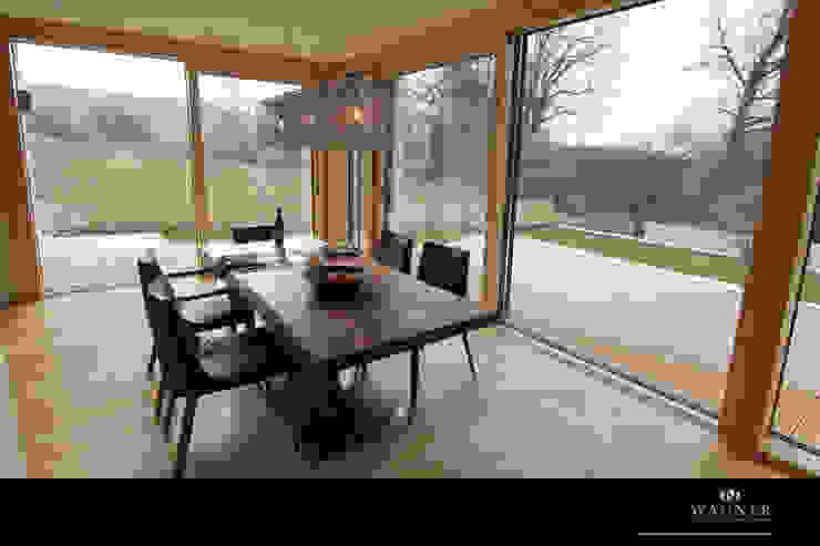 Столовая комната в стиле модерн от Wagner Möbel Manufaktur Модерн