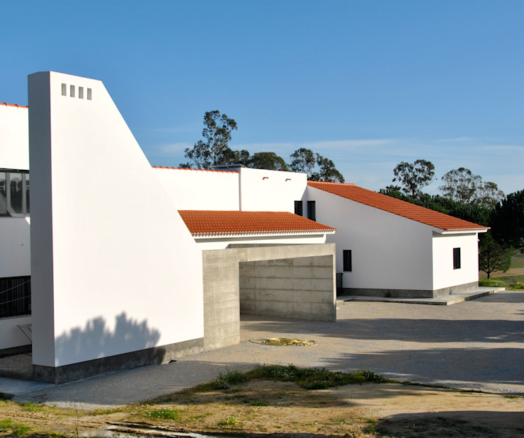 Casas de estilo rústico de é ar quitectura Rústico Concreto