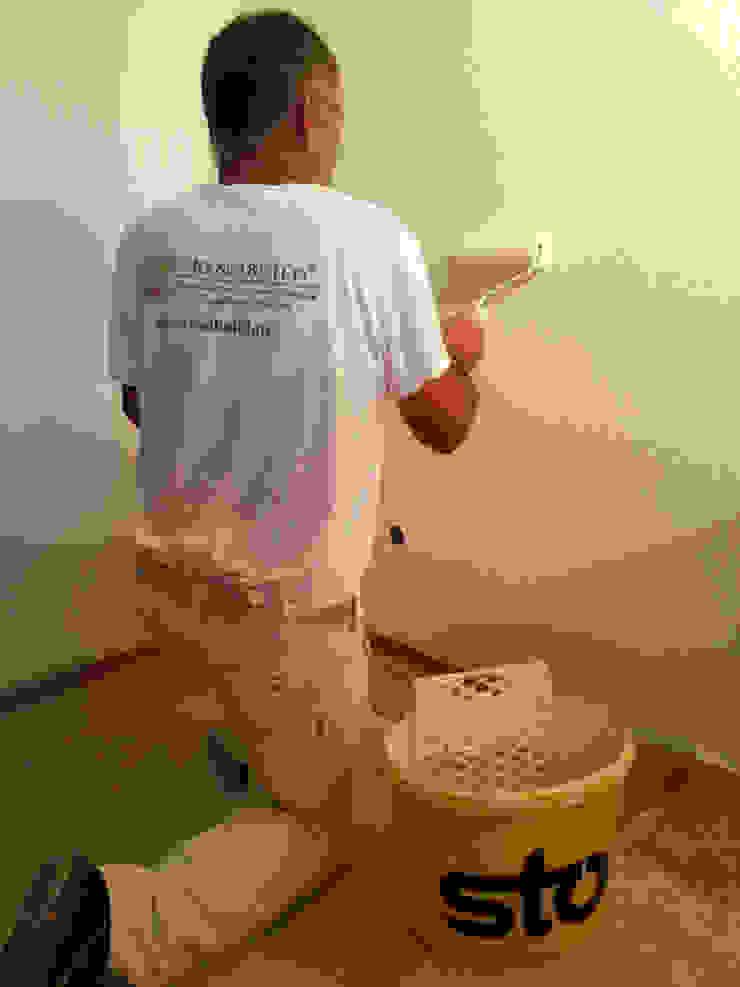 Pintura de interiores Salas de estar rústicas por RenoBuild Algarve Rústico