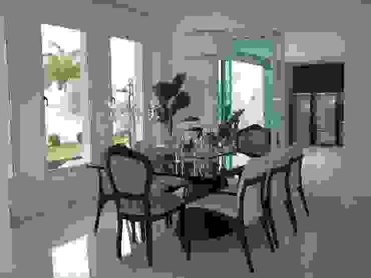 Residência Village Terrasse-Fernandes Salas de jantar modernas por Monica Guerra Arquitetura e Interiores Moderno