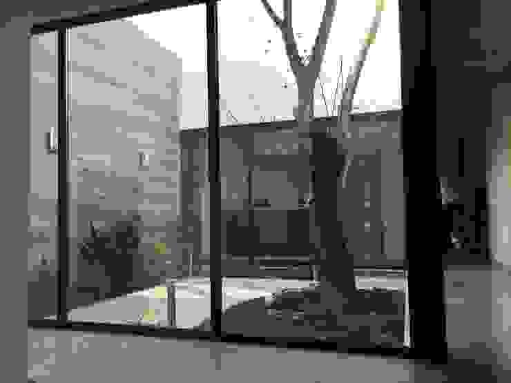 Eclectic style garden by Diez y Nueve Grados Arquitectos Eclectic