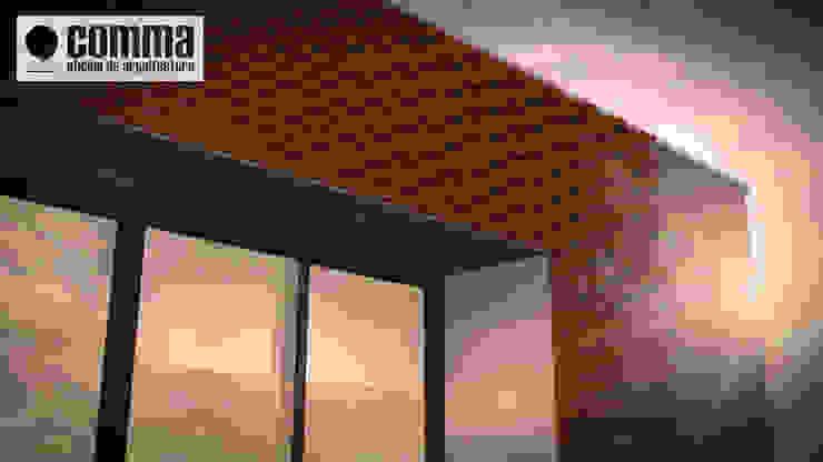 Modern houses by Comma - Oficina de arquitectura Modern Bricks