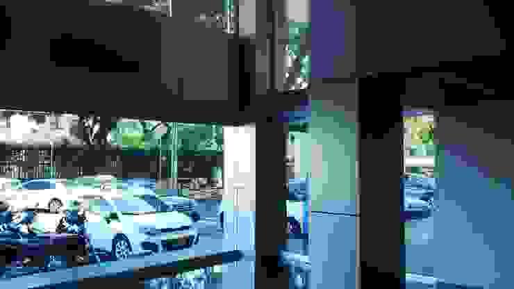 HALL TORRE EMPRESARIAL / Cali de ION arquitectura SAS Minimalista