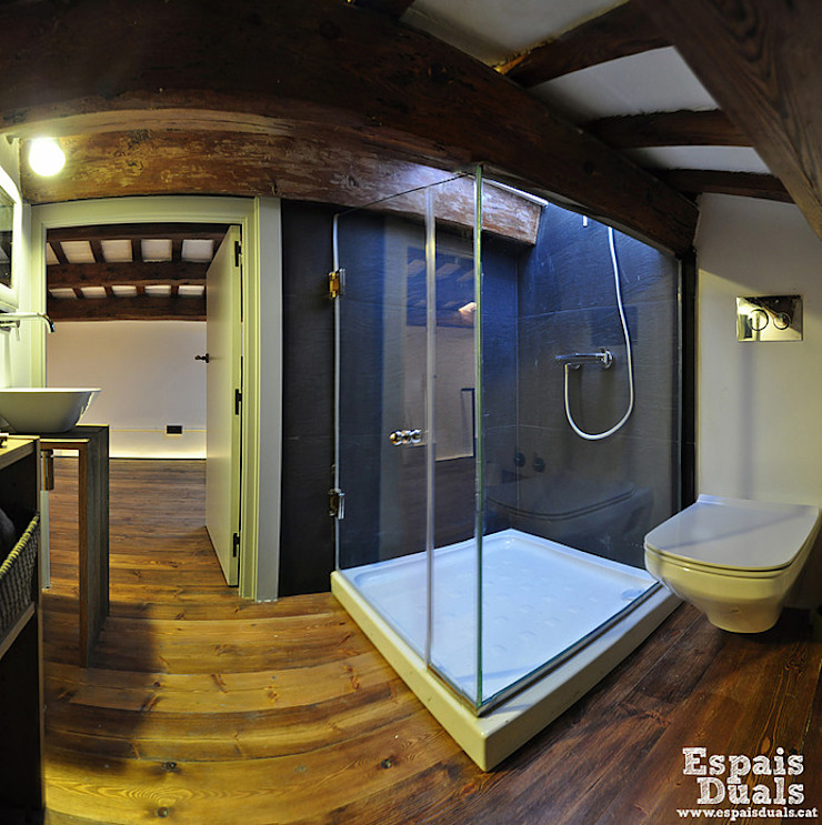 Baños de estilo rústico de Espais Duals Rústico