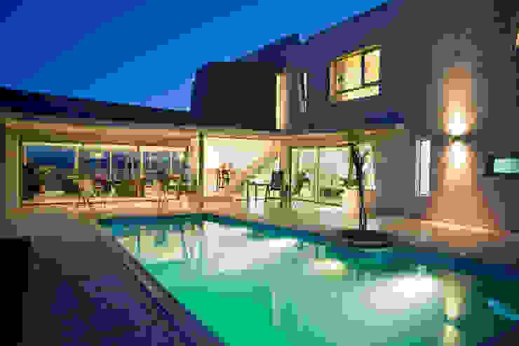 Дома в стиле модерн от Poggi Schmit Arquitectura Модерн
