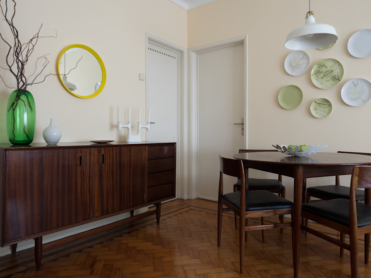 Eclectic style dining room by MUDA Home Design Eclectic