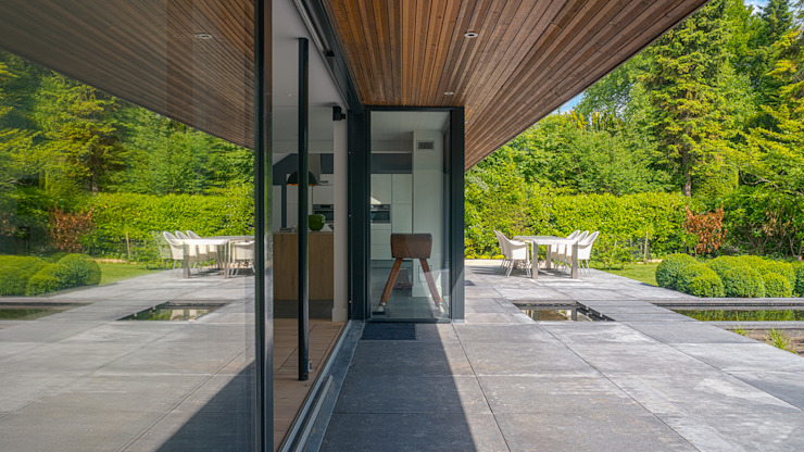 Jardins modernos por Joep van Os Architectenbureau Moderno