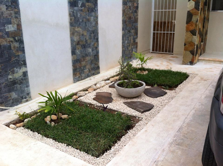 Jardines de estilo  por Constructora Asvial S.A de C.V., Minimalista Piedra