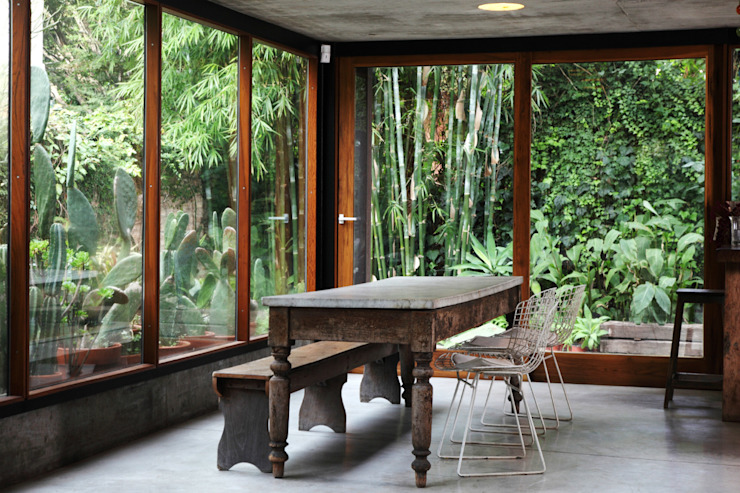 Country style conservatory by Arquitecto Alejandro Sticotti Country