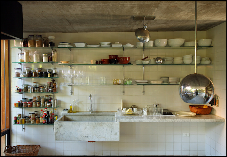 Country style kitchen by Arquitecto Alejandro Sticotti Country