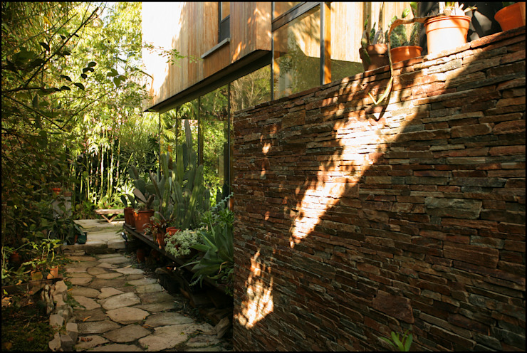Country style garden by Arquitecto Alejandro Sticotti Country