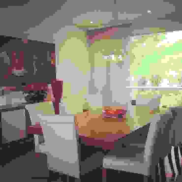Comedor en Apartamento Comedores de estilo clásico de ea interiorismo Clásico Madera maciza Multicolor