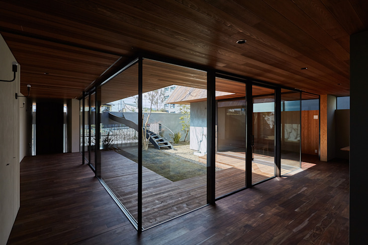 Livings de estilo  por 武藤圭太郎建築設計事務所
