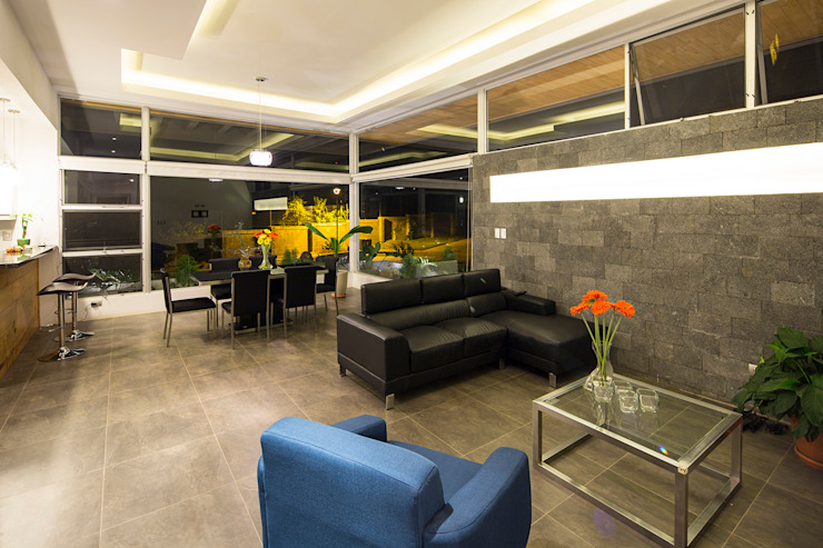 Moderne woonkamers van J-M arquitectura Modern