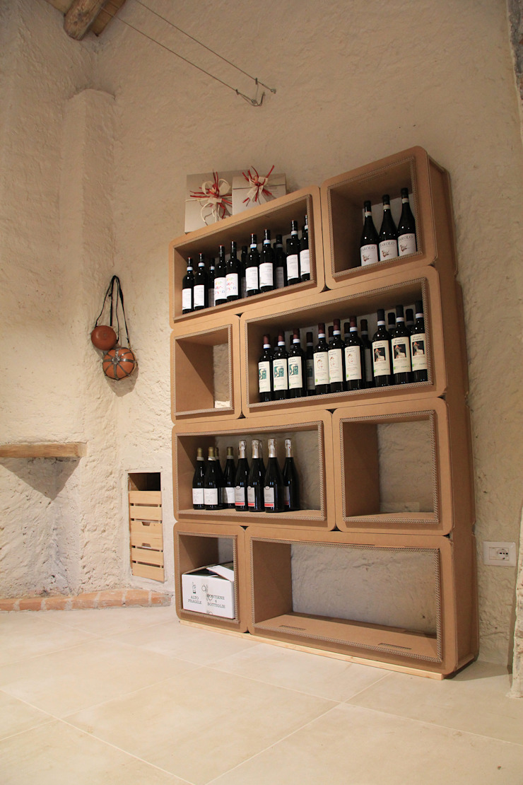 Allestimento Showroom di Cascina Rosa Gastronomia in stile rustico di Etico Design Rustico
