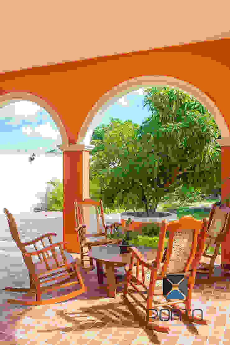 """Proyecto """"Quinta Hunucmá"""" Balcones y terrazas coloniales de PORTO Arquitectura + Diseño de Interiores Colonial"""