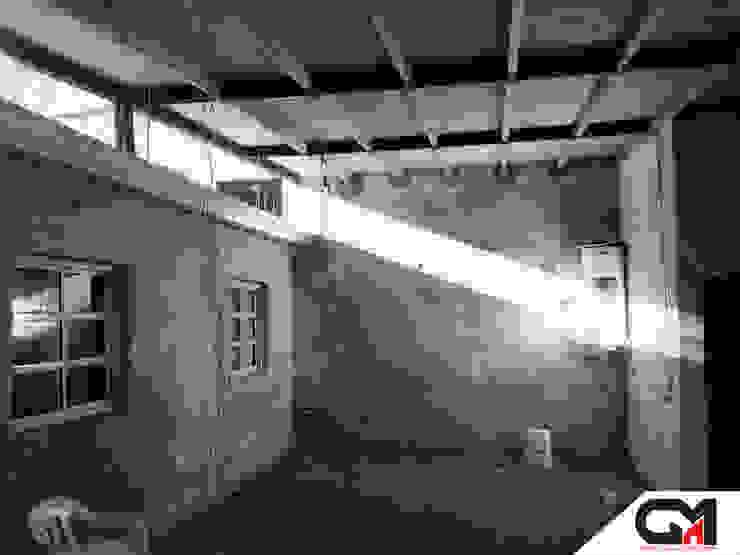 CASA WM Livings modernos: Ideas, imágenes y decoración de GM Arquitectura&Construcción Moderno