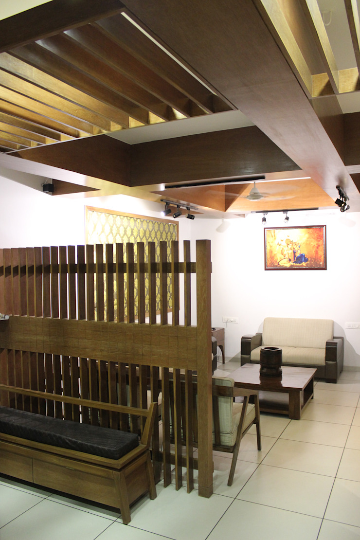 MR. NIMITBHAI DESAI RESIDENCE Rustic style living room by INCEPT DESIGN SERVICES Rustic