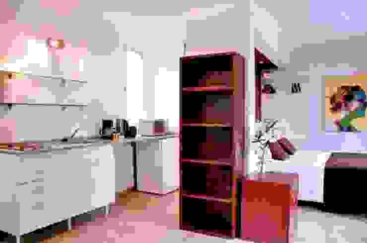 EDIFICIO MODIGLIANI Dormitorios modernos: Ideas, imágenes y decoración de sm arquitectura Moderno