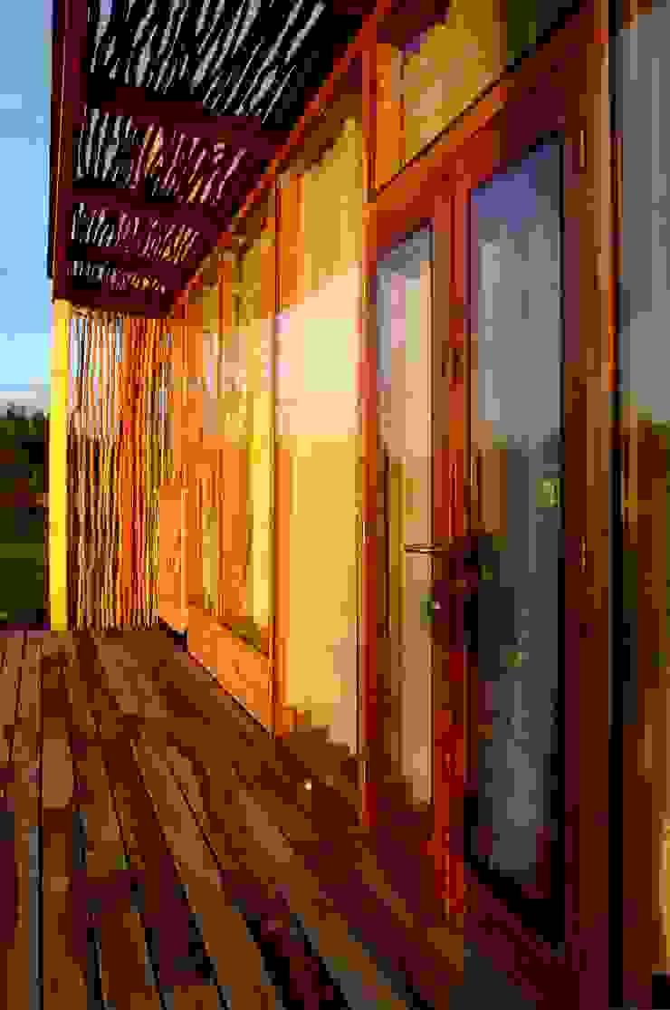 Deck Balcones y terrazas de estilo moderno de PhilippeGameArquitectos Moderno Madera Acabado en madera