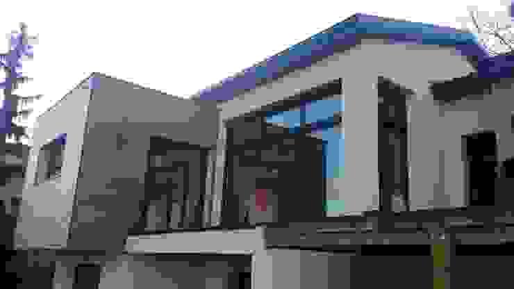 Casas modernas de Concept Creation Moderno Hierro/Acero