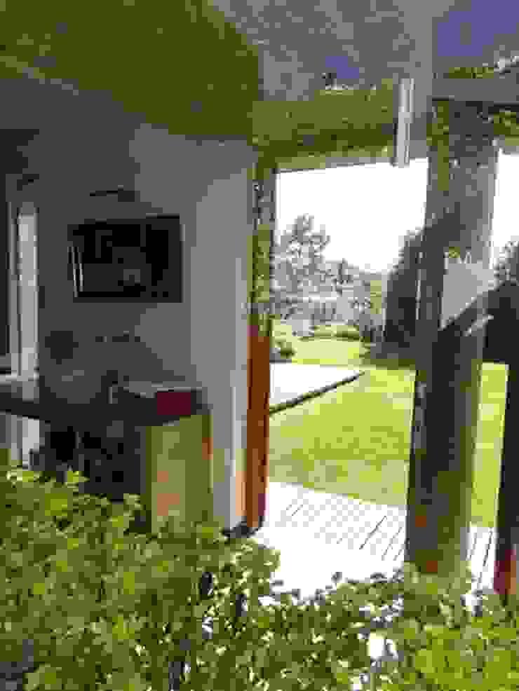 Casa de madera en VILLA ELISA – La Plata Baños rústicos de juan olea arquitecto Rústico
