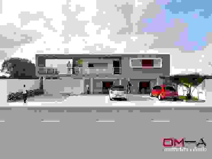 om-a arquitectura y diseño Case in stile minimalista