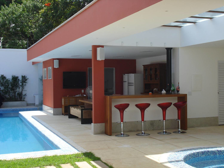 Tropical style houses by GEA Arquitetura Tropical