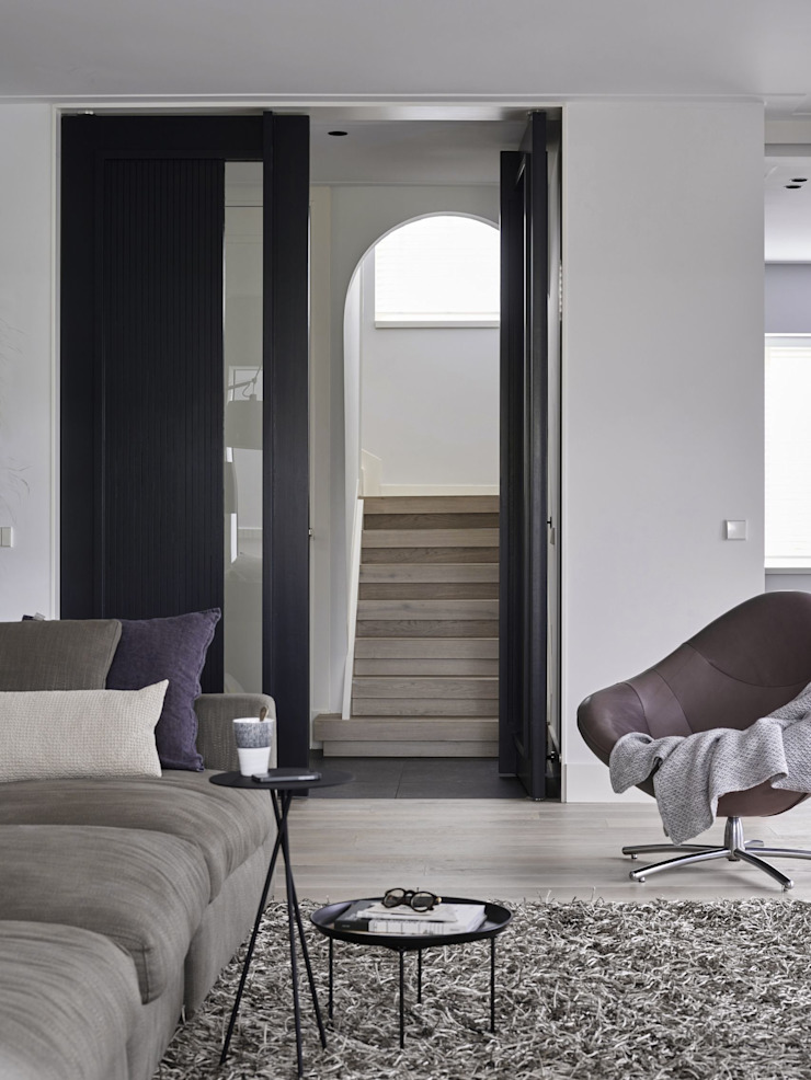 Monument aan de waterkant – vergunningsvrije uitbreiding Moderne woonkamers van ENZO architectuur & interieur Modern