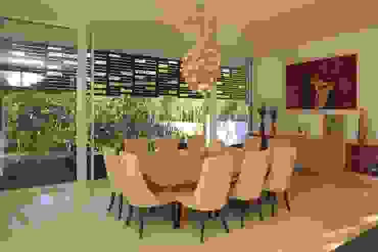Sala Comedores minimalistas de Echauri Morales Arquitectos Minimalista