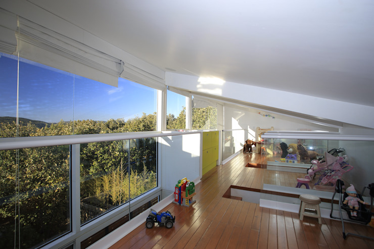 Quarto infantil minimalista por Echauri Morales Arquitectos Minimalista Madeira Efeito de madeira