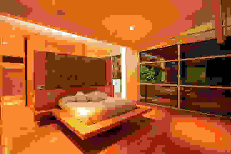 Quartos minimalistas por Echauri Morales Arquitectos Minimalista Madeira Efeito de madeira