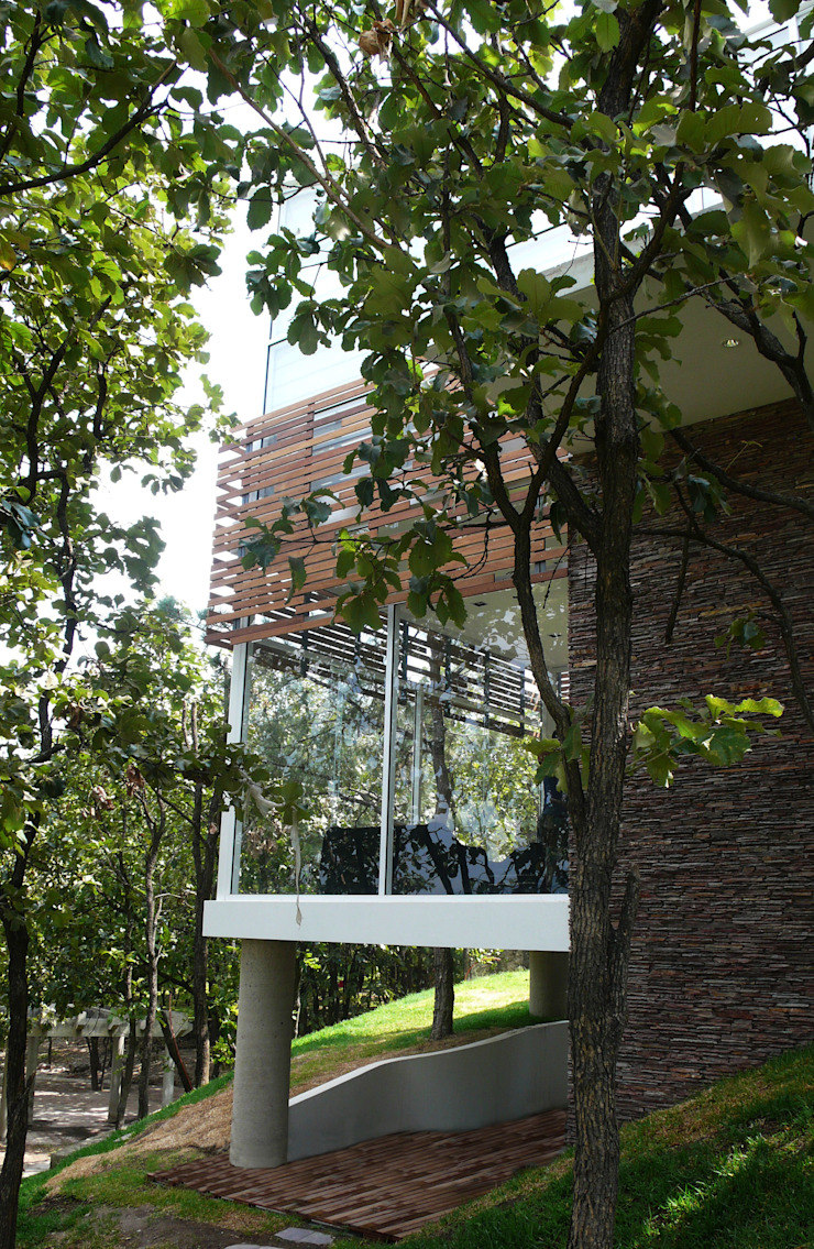 Casas de estilo minimalista de Echauri Morales Arquitectos Minimalista Cerámico